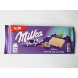 Milka manduladarabokkal töltött kókuszos fehércsokoládé 90G