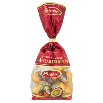 Mozart Mirabell Golyó Zacskós mogyoróval és marcipánnal töltött ét,tej és fehércsokoládé 150G