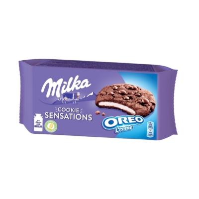 Milka Oreo-s töltelékkel töltött, alpesi tejcsokoládé darabos kakaós keksz 156 g