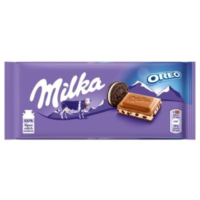 Milka Oreo kakaós kekszdarabkákkal és vaníliaízű tejes krémtöltelékkel töltött alpesi tejcsokoládé 100 g