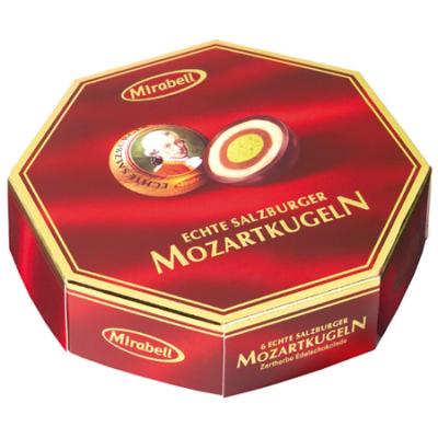 Mozart Mirabell Golyó mogyoróval és marcipánnal töltött ét,tej és fehércsokoládé 100G